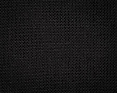 Schwarze Stoffstruktur. Dunkler Textilmusterhintergrund. Detail aus synthetischem Material. Standard-Bild