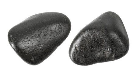 Black stones isolated on white background . Massage stone for use in spa.
