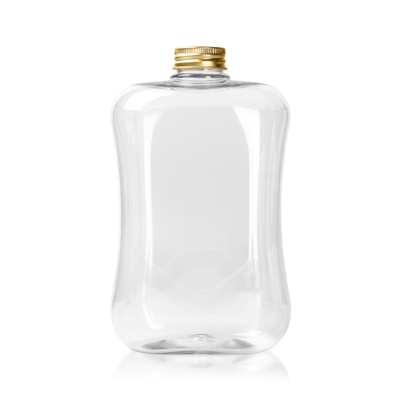 Empty plastic bottle with gold cap isolated on white background . Clear Jar or Mason package.