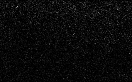 Falling raindrops isolated on dark background. Heavy rain and weather storm in raining season.
