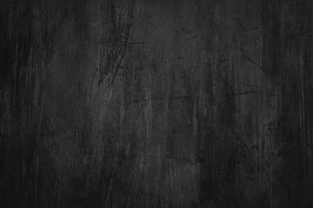 Blank blackboard background with scratches and dust. Detail of scratched chalkboard surface.
