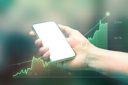 Businessman holding smartphone and showing holographic graphs and stock market statistics gain profits. Concept of growth planning good economy and business strategy. ( Clipping path screen )