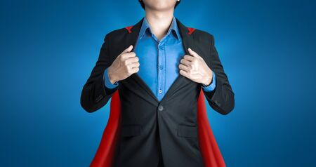 Super business man wears black suits and red robes with super heroes coaching concept on shine blue background and smart. Investors receive a lot of profits with business success.