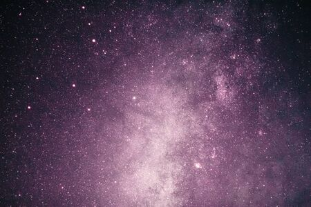 Fantasy of pink milky way galaxy with stars and darkness space background in romance valentine concept. Stock fotó