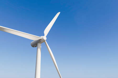 Wind turbines produce sustainable alternative natural energy on clean nature power background with technology for environment. 3D rendering. 免版税图像