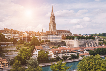 Panoramic view on Bern Minster and historic old town of Bern, capital of Switzerland, Europe. Summer landscape, sunny day and blue sky