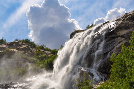 Waterfall scenes in mountains, national park Dombai, Caucasus, Russia, Europe. Sunshine weather and blue sky, summer day 写真素材