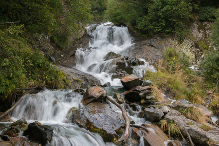 Closeup view waterfall scenes in mountains, national park Dombai, Caucasus, Russia, Europe. Summer landscape, sunshine weather and sunny day 版權商用圖片