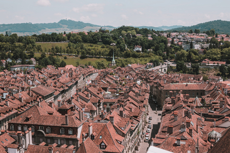 Aerial view of historic Bern city center from Bern Minster, Switzerland, Europe. Summer landscape, sunny day and blue sky