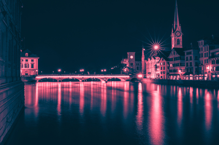 Night view of historic Zurich city center with famous Fraumunster Church, canton of Zurich, Switzerland. Evening summer day 免版税图像