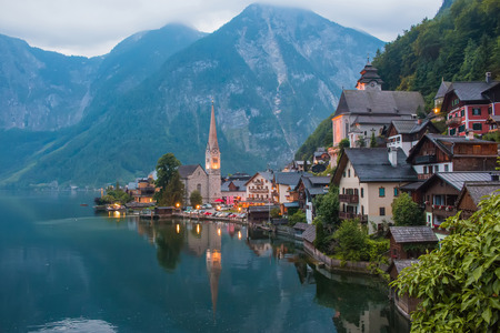 View of Hallstatt village with lake. Far away beauty Alpine rocks and blue sky. Summer day in town Hallstatt, Austria, Europe