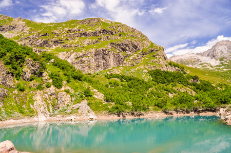 Lake scenes in mountains, national park Dombai, Caucasus, Russia, Europe. Sunshine weather and blue sky Stock Photo