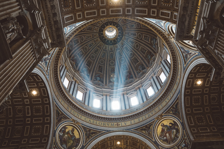 Rome, Italy - June 22, 2018: Panoramic view of interior of Papal Basilica of St. Peter (St. Peters Basilica). It is an Italian Renaissance church in Vatican City, papal enclave within city of Rome