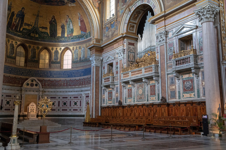 Rome, Italy - June 20, 2018: Panoramic view of interior of Lateran Basilica, also known as Papal Archbasilica of St. John. It is the cathedral church of Rome and serves as seat of the Roman Pontiff