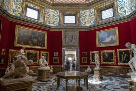 Florence, Italy - June 26, 2018: Panoramic view of interior and arts of Uffizi Gallery (Galleria degli Uffizi) is art museum located adjacent to Piazza della Signoria in Historic Centre of Florence