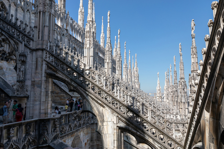 Milan, Italy - June 27, 2018: Closeup facade of Milan Cathedral (Duomo di Milano) is cathedral church of Milan. Dedicated to St Mary of Nativity, it is seat of the Archbishop of Milan