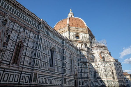 Closeup view of facade of Cattedrale di Santa Maria del Fiore (Cathedral of Saint Mary of the Flower) is the cathedral of Florence