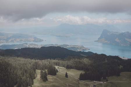Panorama view od Lucerne lake and mountains scene in Pilatus of Lucerne, Switzerland, Europe. Summer landscape, sunshine weather, dramatic blue sky and sunny day