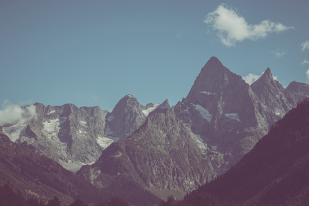 Closeup view of mountains scenes in national park Dombay, Caucasus, Russia, Europe. Summer landscape and sunny blue sky