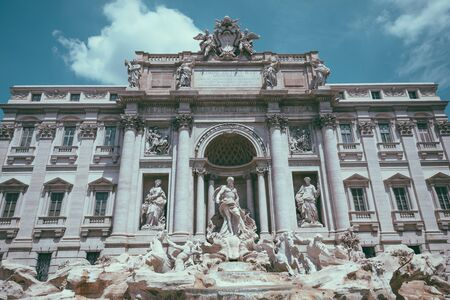 Panoramic view of Trevi Fountain in the Trevi district in Rome, Italy. It designed by Italian architect Nicola Salvi and completed by Giuseppe Pannini Stock Photo