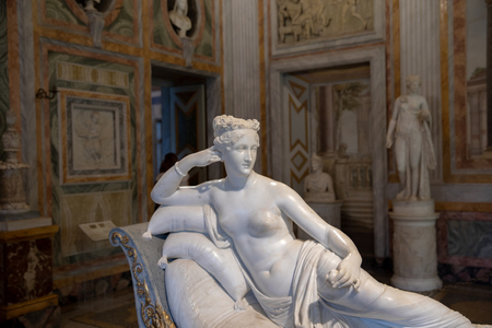 Rome, Italy - June 22, 2018: Baroque marble sculpture Pauline Bonaparte by Antonio Canova in Galleria Borghese of Villa Borghese Editorial