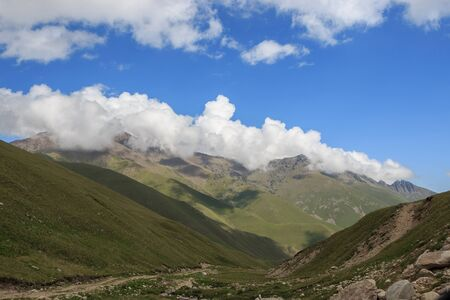Panorama view of mountains scenes in national park Dombay, Caucasus, Russia, Europe. Dramatic blue sky and sunny summer landscape