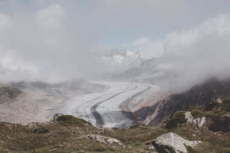 Panorama of mountains scene, walk through the great Aletsch Glacier, route Aletsch Panoramaweg in national park Switzerland, Europe. Summer landscape, sunshine weather, blue sky and sunny day Stock Photo