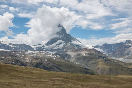 View closeup mountains scene in national park Zermatt, Switzerland, Europe. Summer landscape, sunshine weather, dramatic blue sky and sunny day Stock Photo