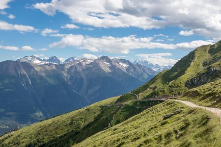 Panorama of mountains scene, route great Aletsch Glacier in national park Switzerland, Europe. Summer landscape, sunshine weather, blue sky and sunny day Stock Photo
