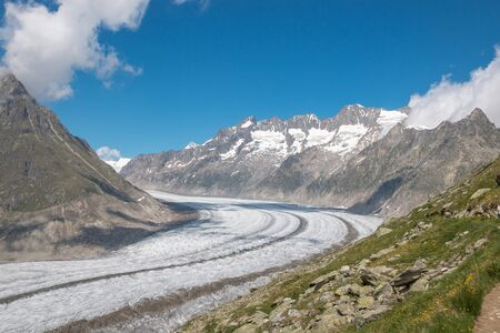 Panorama of mountains scene, walk through the great Aletsch Glacier, route Aletsch Panoramaweg in national park Switzerland, Europe. Summer landscape, sunshine weather, blue sky and sunny day 版權商用圖片