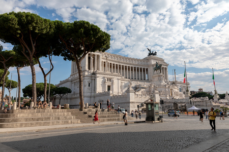 Rome, Italy - June 19, 2018: Panoramic front view of museum the Vittorio Emanuele II Monument also known as the Vittoriano or Altare della Patria on Piazza Venezia in Rome. Summer day and blue sky Редакционное