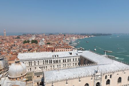 Panoramic view of Venice city with historic buildings and coast from St. Marks Campanile. Landscape of summer day and sunny blue sky