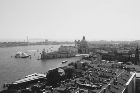 Panoramic view of Venice city and away Basilica di Santa Maria della Salute (Saint Mary of Healt) from St Mark's Campanile (Campanile di San Marco). Landscape of summer day and sunny blue sky