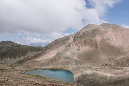 Panorama of lake scenes in mountains, national park Dombay, Caucasus, Russia, Europe. Dramatic blue sky and sunny landscape in summer day Banco de Imagens