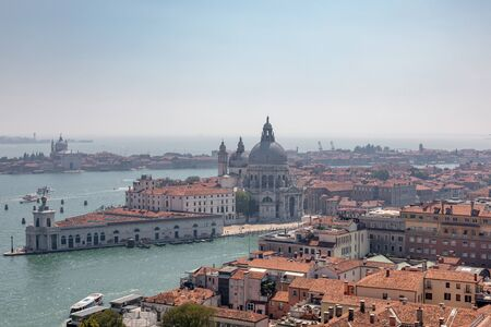 Panoramic view of Venice city and away Basilica di Santa Maria della Salute (Saint Mary of Healt) from St Marks Campanile (Campanile di San Marco). Landscape of summer day and sunny blue sky