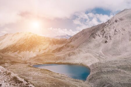 Panorama of lake scenes in mountains, national park Dombay, Caucasus, Russia, Europe. Dramatic blue sky and sunny landscape in summer day Stock Photo