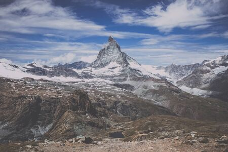 View closeup Matterhorn mountain, scene in national park Zermatt, Switzerland, Europe. Summer landscape, sunshine weather, dramatic blue sky and sunny day Stock Photo