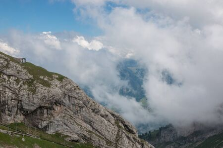 Panorama view of mountains scene from top Pilatus Kulm in national park Lucerne, Switzerland, Europe. Summer landscape, sunshine weather, dramatic blue sky and sunny day