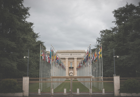 Geneva, Switzerland - July 1, 2017: National flags at the entrance in UN office at Geneva, Switzerland. The United Nations was established in Geneva in 1947 and is the second largest UN office Redakční