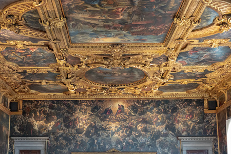 Venice, Italy - June 30, 2018: Panoramic view of hall interior and arts in Doges Palace (Palazzo Ducale) is a palace built in Venetian Gothic style on Piazza San Marco