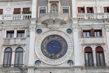 Venice, Italy - July 1, 2018: Closeup facade of the Clock Tower in Venice is an early Renaissance building on the north side of the Piazza San Marco