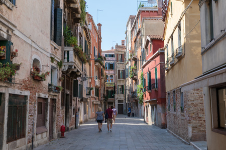 Venice, Italy - July 1, 2018: Panoramic view of Venice narrow street with historical buildings Landscape of summer sunny day