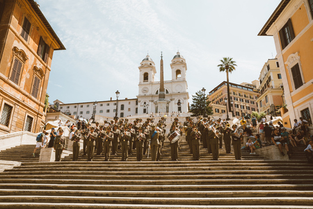 Rome, Italy - June 21, 2018: Panoramic view of the Spanish Steps on Piazza di Spagna in Rome. The orchestra plays on the steps and people rest near