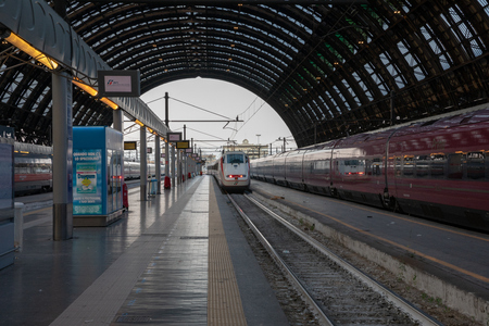 Milan, Italy - June 27, 2018: Trains are waiting of departure inside of Milano Centrale (Stazione Milano Centrale) is the main railway station of city of Milan