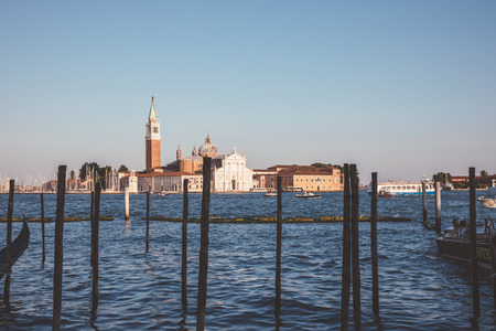 Panoramic view of Laguna Veneta of Venice city and away San Giorgio Maggiore Island. Landscape of summer evening day and sunny blue sky Redactioneel