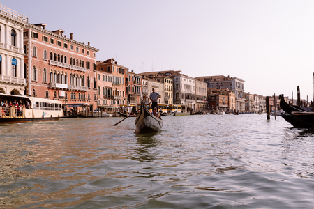 Venice, Italy - July 2, 2018: Panoramic view of Grand Canal (Canal Grande) from gondola with active traffic gondolas. Grand Canal it is forms one of the major water-traffic corridors in Venice city Redactioneel