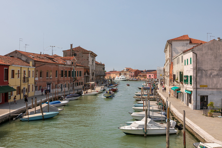 Murano, Venice, Italy - July 2, 2018: Panoramic view of Murano island is a series of islands linked by bridges in the Venetian Lagoon, northern Italy. Summer sunny day and blue sky