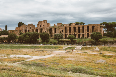 Rome, Italy - June 23, 2018: Panoramic view of temple of Apollo Palatinus on Palatine Hill of ancient Rome and Circus Maximus (Circo Massimo) is an ancient Roman racing stadium and mass entertainment Редакционное