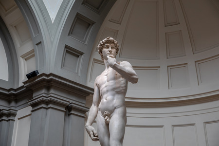 Florence, Italy - June 24, 2018: Closeup of Renaissance sculpture is David by Michelangelo, created in between 1501 and 1504 in Academy of fine arts of Florence (Accademia di Belle Arti di Firenze) Editorial