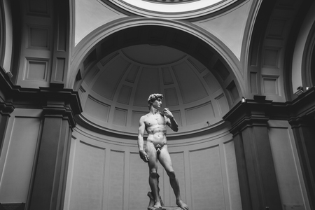 Florence, Italy - June 24, 2018: Closeup of Renaissance sculpture is David by Michelangelo, created in between 1501 and 1504 in Academy of fine arts of Florence (Accademia di Belle Arti di Firenze) Stockfoto - 129745029